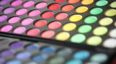 arcszín : Make-up, colorful eye shadows palette, set of colored shadows for make-up, Shallow depth of field, close-up Stock mozgókép