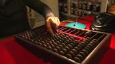 calculator : Man calling the old phone, wooden abacus in the office Stock Footage