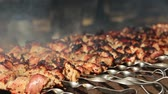 labareda : Preparing tasty meat barbeque on skewers in sunny day, roast barbecue, barbecue a lot, roasted kebabs on the grill Stock Footage