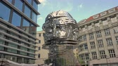 cinético : Prague, Czech Republic - May 2017: Statue Metalmorphosis by Czech sculptor David Cerny. Long shot