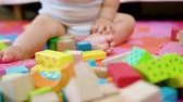 prole : Cute baby playing on the floor at home. Close-up shot Stock Footage