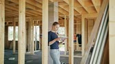 крыша : A young lady using a tablet in a house under construction. Long shot. Soft focus. Medium shot
