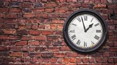 numerais : A Time-lapse Of A Grungy Retro Station Clock Moving Through 24 Hours Against A Red Brick Wall With Copy Space