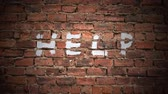 rescue : The Word Help Written As Graffiti On A Vintage Red Brick Wall