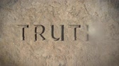 押す : Conceptual Fake News Image Of The Word Truth Disappearing From Stone