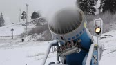 forcing : Snowmaking is the production of snow by forcing water and pressurized air through a snow gun or snow cannon, on ski slopes. Snowmaking is mainly used at ski resorts to supplement natural snow Stock Footage