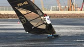 surfe : winter windsurfing Slalom participant World Cup in sailing in the winter,  disciplines snowkiting and windsurfing. St. Petersburg from February 28 to March 3, 2014 tracking shot Stock Footage