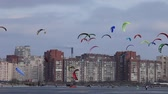surfe : colored snowkiting in the sky over a city Stock Footage