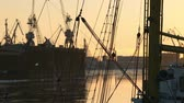 cordame : view of the harbor from on board sailing ship during golden hour