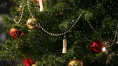 bead : snowflakes falling on Christmas tree with toys camera is in motion Stock Footage