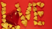 stopmotion : cookies in the shape of hearts falling down on a red background Stop motion Stock Footage