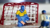 goleiro : attack ice hockey match, table game, macro shot, sequence