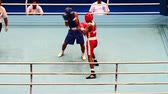 uppercut : St. Petersburg, Russia, November 23, 2016 Youth World Boxing Championship men 64 kg  RED - Ashish, India, BLUE Margarian S.  Russia.