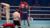 uppercut : St. Petersburg, Russia, November 23, 2016 Youth World Boxing Championship men 91 kg  Boxing match RED - Huni J., Austria; BLUE- Hovhannisyan G., Armenia with sound Stock Footage