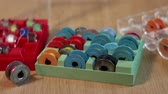thread bobbins for sewing machine in box camera motion close up. Stok Video