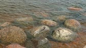 eroze : Round smooth boulders washed by waves close to