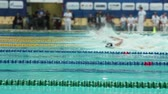 swimming competition tracking shot
