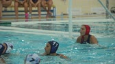 goleiro : Water polo team game with a ball in the swimming