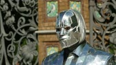 Man in the Iron Mask, takes off his hat Living statue performer Stock Footage