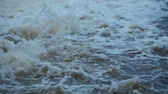 現在 : Fast white water, rapids on a mountain river, slow motion