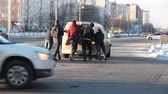 unrecognizable people push accidents car at crossroads