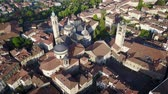 mavic : Drone aerial view of Bergamo - Old city (Cities † High). One of the beautiful city in Italy. Landscape on the city center, the main square and its historical buildings during a wonderful blue day