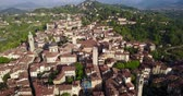 mavic : Drone aerial view of Bergamo - Old city . One of the beautiful city in Italy. Landscape on the city center, the main square and its historical buildings during a wonderful blue day