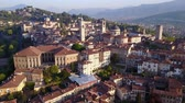 mavic : Drone aerial view of Bergamo - Old city. One of the beautiful cities in Italy. Landscape on the city center, the main square and its historic buildings during a wonderful blue day Stock Footage