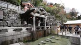KYOTO, JAPAN - NOVEMBER 30: Visitors catch and drink the clear water at Kiyomizu-dera temple which is believed to have wish-granting powers on November 30, 2012 in Kyoto, Japan.