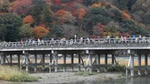 KYOTO, JAPAN - DECEMBER 1: People visit Togetsukyo bridge on December 1, 2012 in Arashiyama area, Kyoto, Japan. Togetsukyo bridge is the areas landmark, dates back to 9th century.