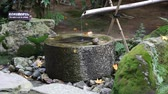 Japanese style traditional bamboo fountain at Ryoan-ji temple, Kyoto, Japan.