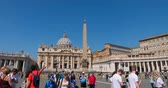 pope : 4k hyperlapse passage through square turn of tourists wishing to go inside church