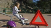 elbow : The child is resting and eat snacks in the park on rollerblade
