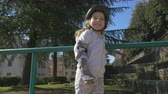 patenci : Cute little girl overcome the fear of roller blading