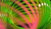 gamma : Abstract backgroundRed and green spiral lines backgroundSpiral backgroundLine backgroundColored art backgroundSlinky toy closeupDefocused color curve linesSpiral backgroundPlastic toy macro