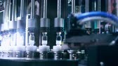 produtos químicos : Pharmaceutical machine. Automated quality control equipment. Medical vials on production line at pharmaceutical factory. Pharmaceutical technology. Quality control at pharmaceutical industry Stock Footage