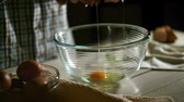 chef kitchen : Man hand breaking chicken egg. Chef breaking egg. Close up of male hand cracked egg into a glass bowl. Breaking eggs. Preparation of ingredients for baking. Cooking food. Food ingredient