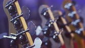 тон : Electric guitar head selective focus. Close up of electric guitar headstock. Electric guitar neck. String instruments. Music guitar headstock. Music instruments background