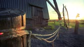 начало : Wheel for launching windmill turning on rural farm background. Old windmill and wheel to start. Traditional windmill farm equipment. Wind mill background Стоковые видеозаписи