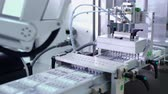 produtos químicos : Automated production line. Medical ampoules on pharmaceutical manufacturing line. Pharmaceutical industry. Packaging machine at pharmaceutical plant. Industrial equipment. Modern technology