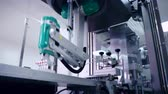 robotický : Robotic arm working at automated production line. Modern technology. Industrial equipment at pharmaceutical plant. Packaging machine. Pharmaceutical manufacturing equipment. Medicine manufacturing