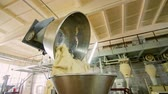yeast : Industrial dough mixing machine in bread factory. Wheat flour dough machine at baking factory. Bakery manufacture process. Dough kneading before baking. Baking machinery