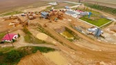 lerak : Aerial view of dump trucks with sand standing on territory industrial factory. Tipper trucks on industrial plant sky view. View from above cargo trucks on territory sand quarry. Sand work