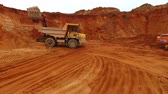yükleme : Dumper truck moving at sand mine. Drone view of mining truck working at sand quarry. Dump truck working at sand area. Industrial machinery at sand quarry. Mining industry. Construction industry