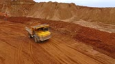 dumper : Sand truck moving at sand mine. Aerial view of mining truck transporting sand at quarry. Dump truck at sand pit. Mining machinery at industrial area. Mining industry