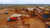 dumper : View from above mining conveyor working on sand mine. Mining conveyor pour sand in dumper truck. Mining equipment on industrial park. Aerial view of mining machinery on sand quarry