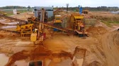 lerak : Sky view of mining conveyor sorting sand. Sand on mining conveyor belt. Aerial view of sand work in sandpit. Top view of mining conveyor pour sand in dumper truck. Mining equipment at quarry