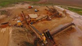 dumper : Industrial equipment at mining area. Sky view of mining equipment at sand mine. Mining conveyor working at sandpit. Aerial view of mining machinery at sand quarry. Sand work