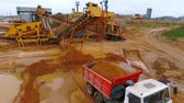 dumper : Mining conveyor pour sand in dumper truck. Mining equipment working at sand mine. Industrial conveyor belt at sandpit. Aerial view of mining machinery at sand quarry. Sand mining. Aerial industrial