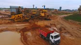 lerak : Aerial view of mining conveyor filling sand in dump truck. Mining conveyor belt working at sand mine. Mining equipment at sand quarry. Mining industry. Aerial industrial view